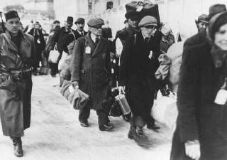 Deportation of Slovak Jews. The victims wear tags and...