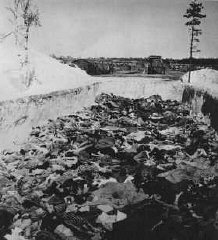 After camp liberation, one of the mass graves at the...