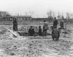 Prisoners at forced labor under SS and police guard in the Oranienburg concentration camp.