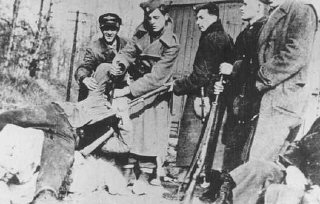 Ustasa (Croatian fascist) soldiers kill a victim with...