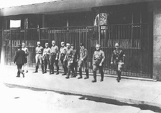 Nazi Storm Troopers (SA) block the entrance to a trade union building that they have occupied.