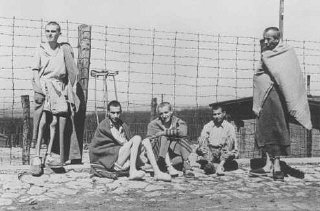 Emaciated survivors of the Buchenwald concentration...