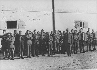 Prisoners in the Janowska concentration camp orchestra, which performed as workers were taken to and from forced labor. Poland, between 1941 and 1943.