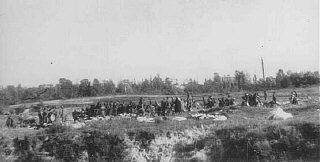 At Babi Yar, members of Einsatzgruppe (mobile killing unit) C force groups of Jews to hand over their possessions and undress before being shot in the ravine. Near Kiev, Soviet Union, September 29 or 30, 1941.