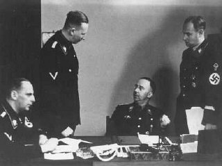 Heinrich Himmler (seated, center), chief of the SS...