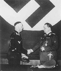 Hermann Goering (right), prime minister of Prussia...