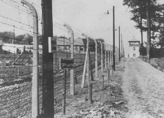View of a guard tower and fence at the Buchenwald concentration camp.