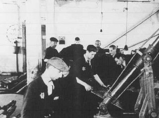 Jewish forced laborers at work in a leather refining factory.