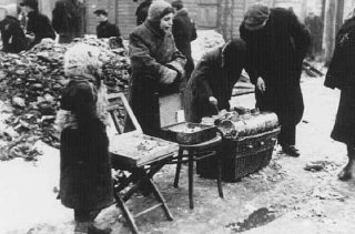 Child street vendors. Lodz ghetto, Poland, 1942.