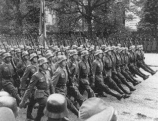German troops parade through Warsaw after the surrender of Poland.