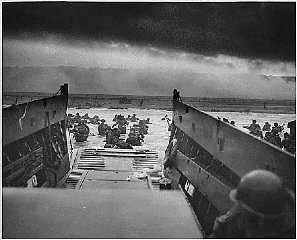 US troops wade ashore at Normandy on D-Day, the beginning...