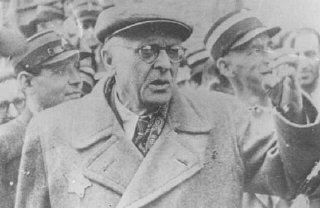 Mordechai Chaim Rumkowski, Jewish council chairman in Lodz ghetto, seen here speaking amongst Jewish ghetto policemen.