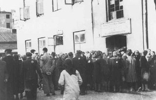 Jews in the Lodz ghetto line up outside the labor office...