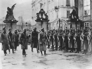 Adolf Hitler reviews his troops at Prague castle on...