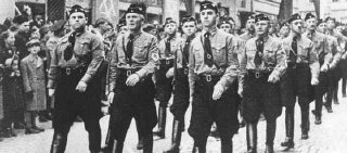 Members of the Hlinka Guard march in Slovakia, a Nazi...