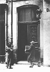 A Jewish women carries her radio into a police station...