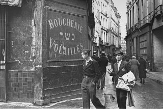 A young man in the Jewish quarter of Paris wears the...