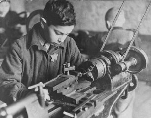 Child forced laborer in a ghetto factory.