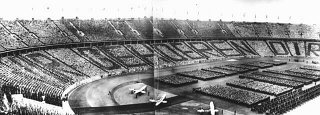"At a ceremony during the 1936 Olympic Games, German spectators spell out the phrase, directed at Adolf Hitler, ""Wir gehoeren Dir"" [We belong to you]. Berlin, Germany, August 1936."