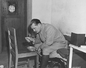 Hermann Goering eats breakfast in his cell while awaiting the opening of the day's court proceedings.