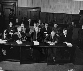 The I. G. Farben defendants hear the indictments against...