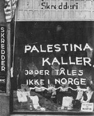 On a Jewish-owned shop, Norwegian fascists painted...