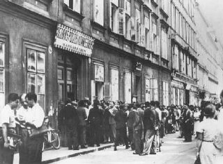Jews wait in line at the Margarethen police station...