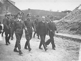 SS chief Heinrich Himmler (front row, left) and Mauthausen...