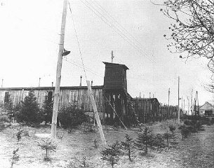 View of a watchtower and prisoner barracks at the Ohrdruf...