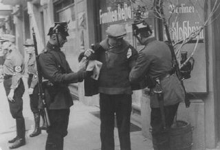 Police search in Berlin. Germany, 1933.