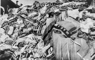 Piles of prayer shawls that belonged to Jewish victims, found after the liberation of the Auschwitz camp.