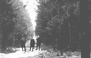 Three Jewish partisans in Wyszkow Forest near Warsaw.