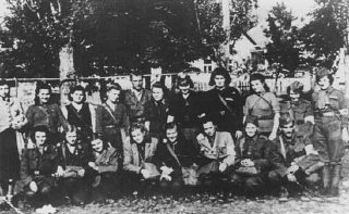 Jewish partisans pose for a group photo in the Carpathian...