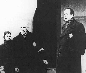 In a scene from a Nazi propaganda film, Dr. Paul Eppstein (right), Council of Elders chairman, addresses Dutch Jews. Theresienstadt ghetto, Czechoslovakia, August 1944.