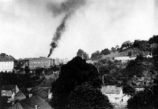 Smoke rising from the chimney at Hadamar, one of six...