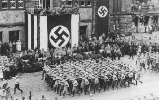 Battalions of Nazi street fighters salute Hitler during...