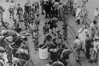 British soldiers force passengers of the refugee ship...