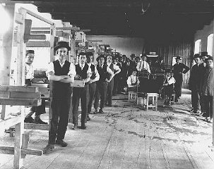 Prewar photograph of students in a weaving workshop at a yeshiva (rabbinical academy) in the northern Transylvanian town of Sigh
