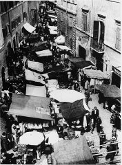 Scene during an open market in prewar Rome's Jewish section. Rome, Italy, before 1939.