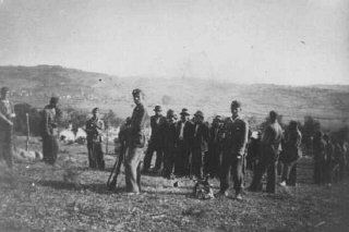 Ustasa (Croatian fascist) soldiers lead people to their execution in Herzegovina, in the pro-German fascist state of Croatia est