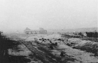 View after the obliteration of the Belzec extermination camp: railway shed where victims' belongings were stored. Belzec, Poland, 1944.
