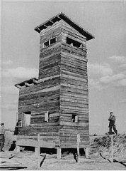 Ustasa (Croatian fascist) guard next to a watchtower...