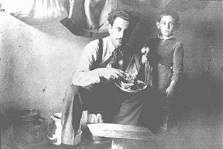 Mr. Mandil and his son Gavra, Yugoslav Jews, while in hiding. The Mandil family escaped to Albania in 1942. After the German occupation in 1943, Mandil's Albanian apprentice hid the family, all of whom survived. Albania, between 1942 and 1945.