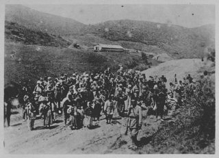 Ottoman troops guard Armenians being deported.