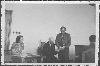 American prosecutor Robert Kempner shows a document...