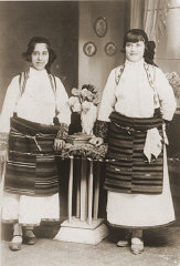 Portrait of two Jewish girls dressed in traditional...