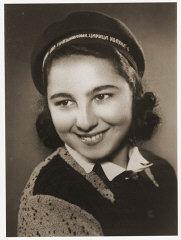 Portrait of Stella Nahmiyas in her school cap.