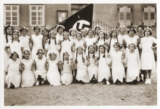 Group portrait of German girls posing outside their...