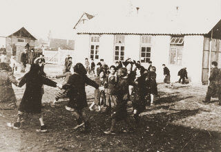 Romani (Gypsy) children play outside at the Jargeau...