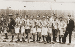 Members of a soccer team in Bitola pose in the goal...
